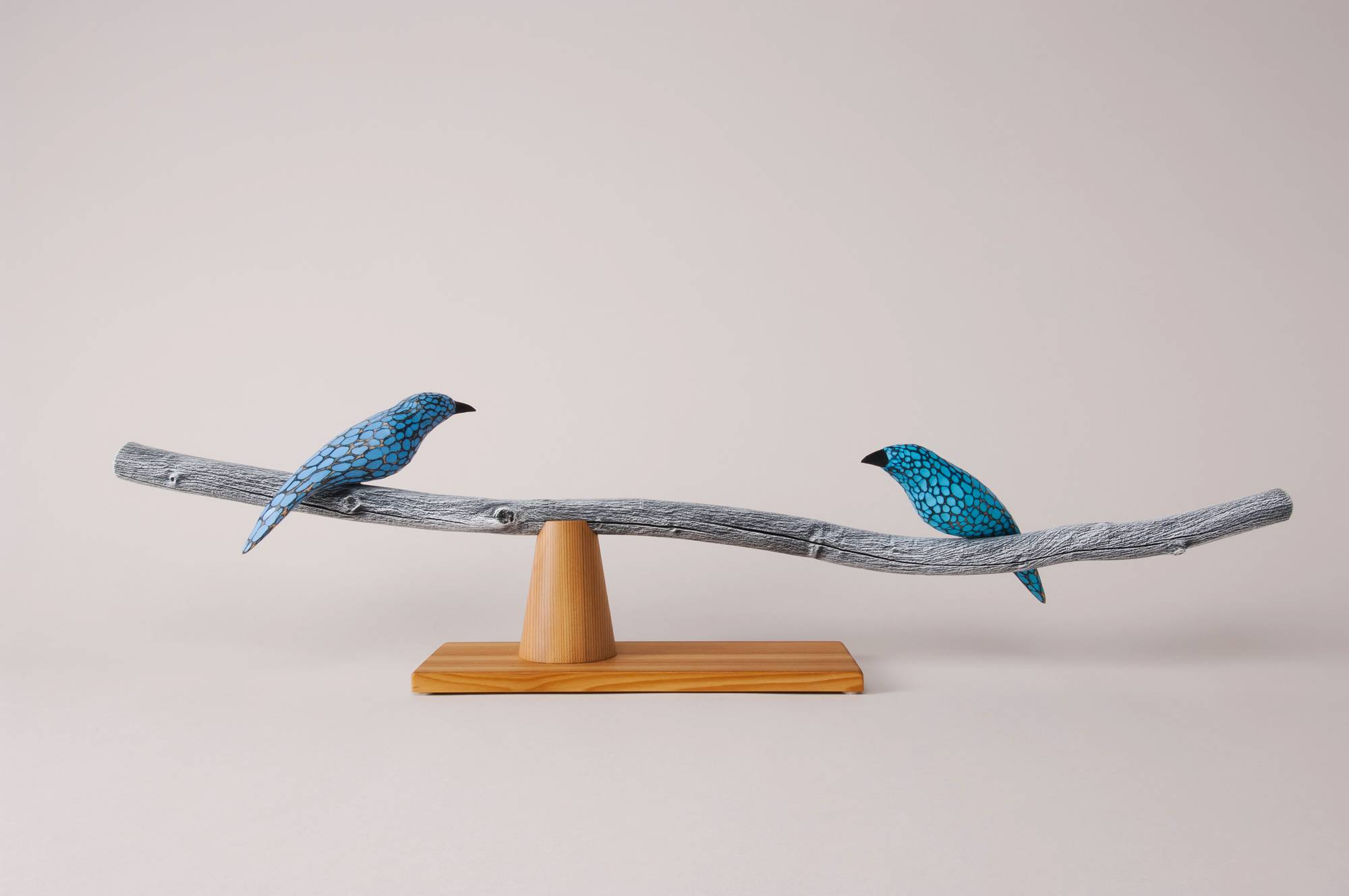 handcrafted sculpture blue wooden birds on branch