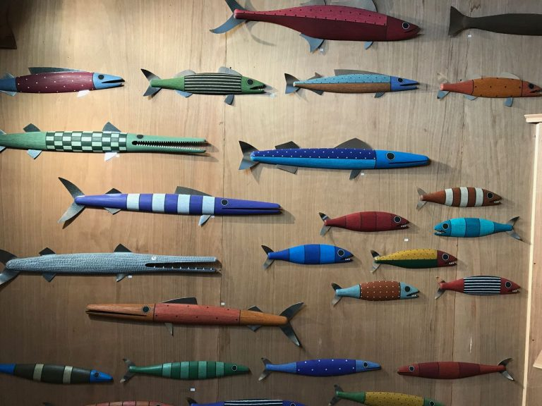 hand crafted wooden fish sculptures
