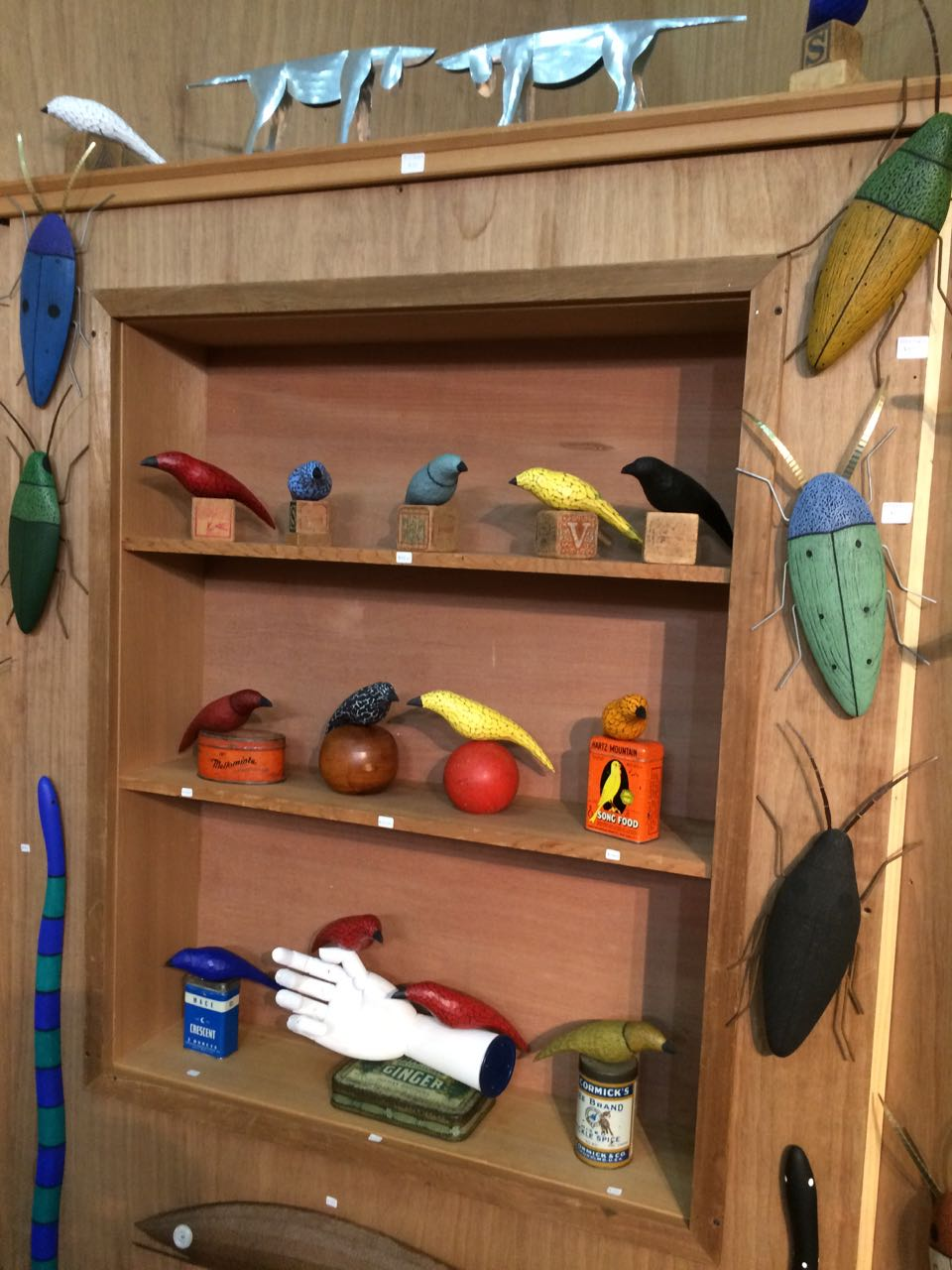 Bird display in booth on retail days of the 2018 ACC Baltimore show.