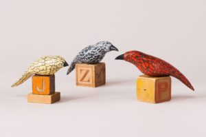 hand carved and painted pine birds on antique toy blocks