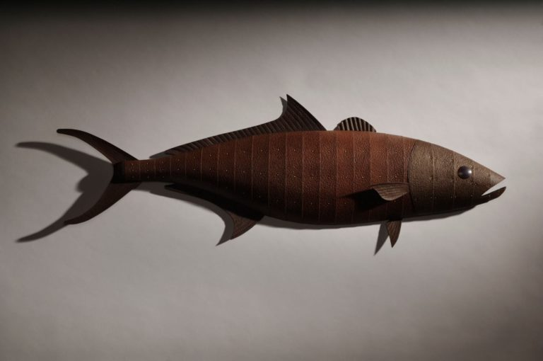 hand crafted wooden fish sculpture with rusted metal plating and fins