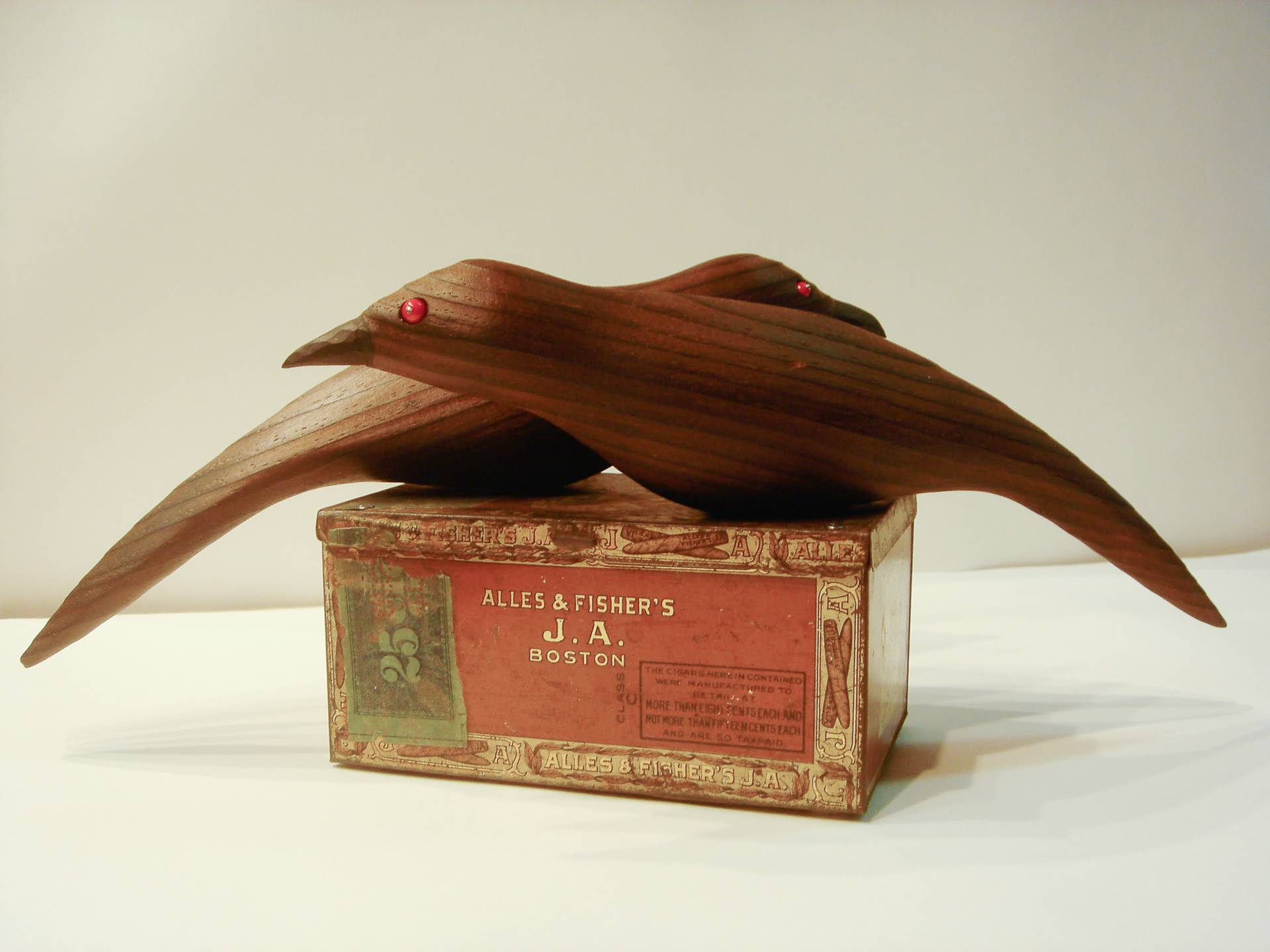 hand crafted brushed and waxed cedar birds on an antique tobacco tin