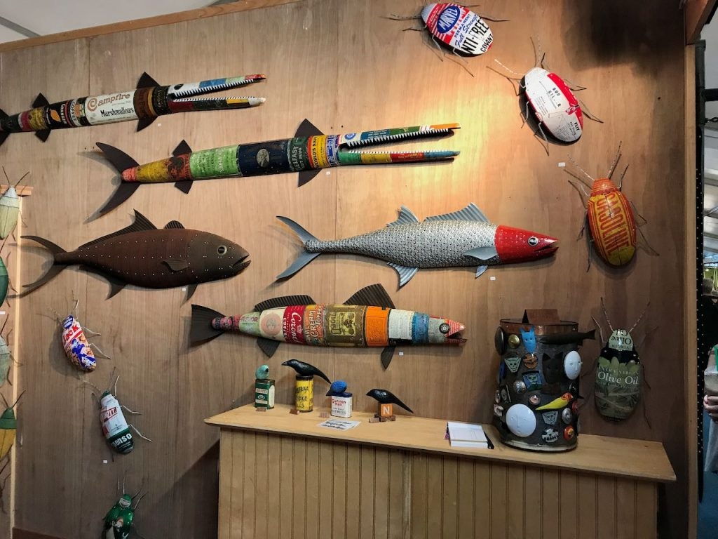 2019 ACE booth with metal-clad fish, large tin bugs, birds and magnets