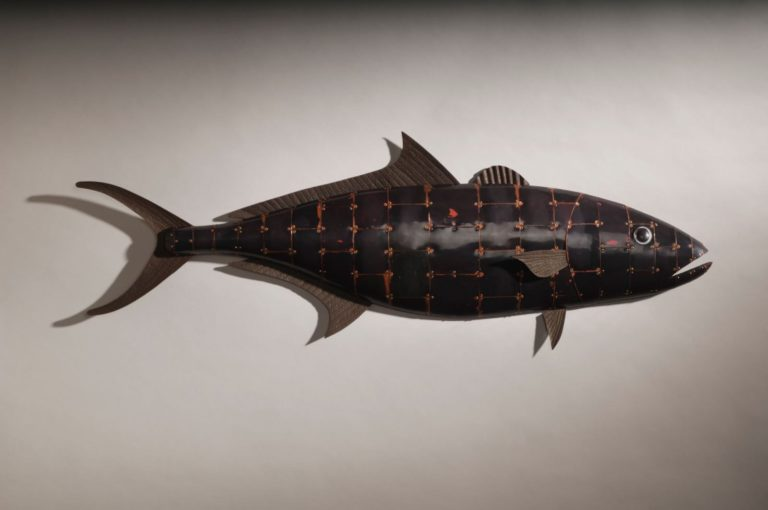 hand crafted wooden fish sculpture with metal plating and fins