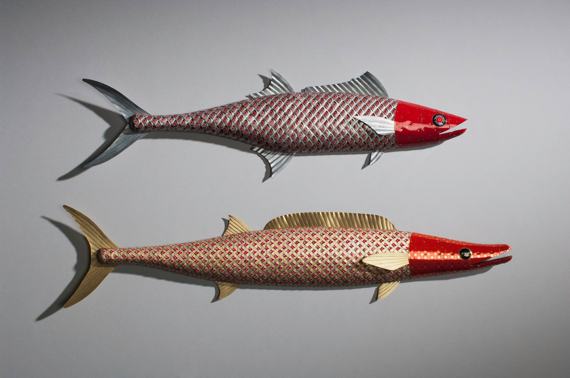 hand crafted wooden fish sculptures with bottle cap plating and metal fins