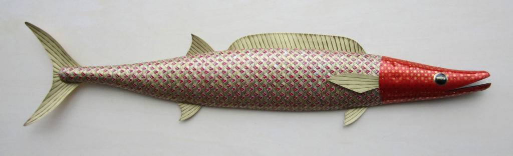 hand crafted wooden fish sculpture with bottle cap plating and metal fins