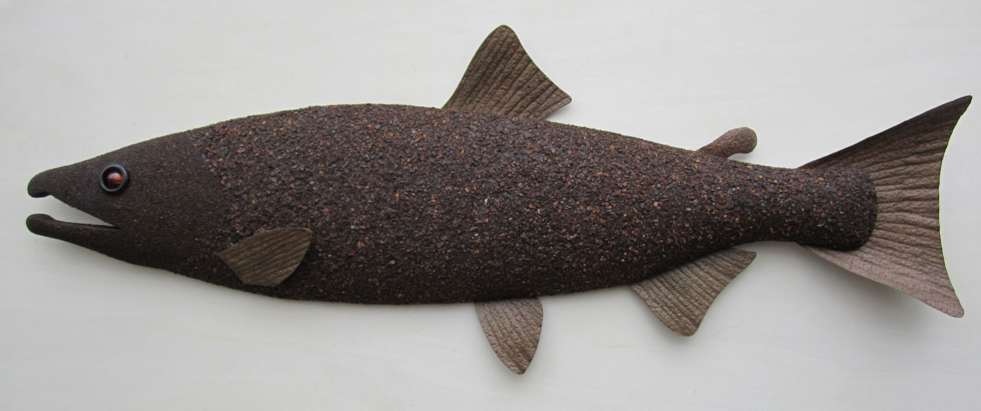 hand crafted wooden fish sculpture with rust texture coating
