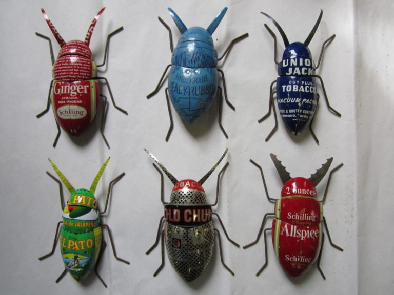 Hand carved plated beetles, pine with carefully fitted tin exoskeleton screwed in place, pose-able rusty fence wire legs