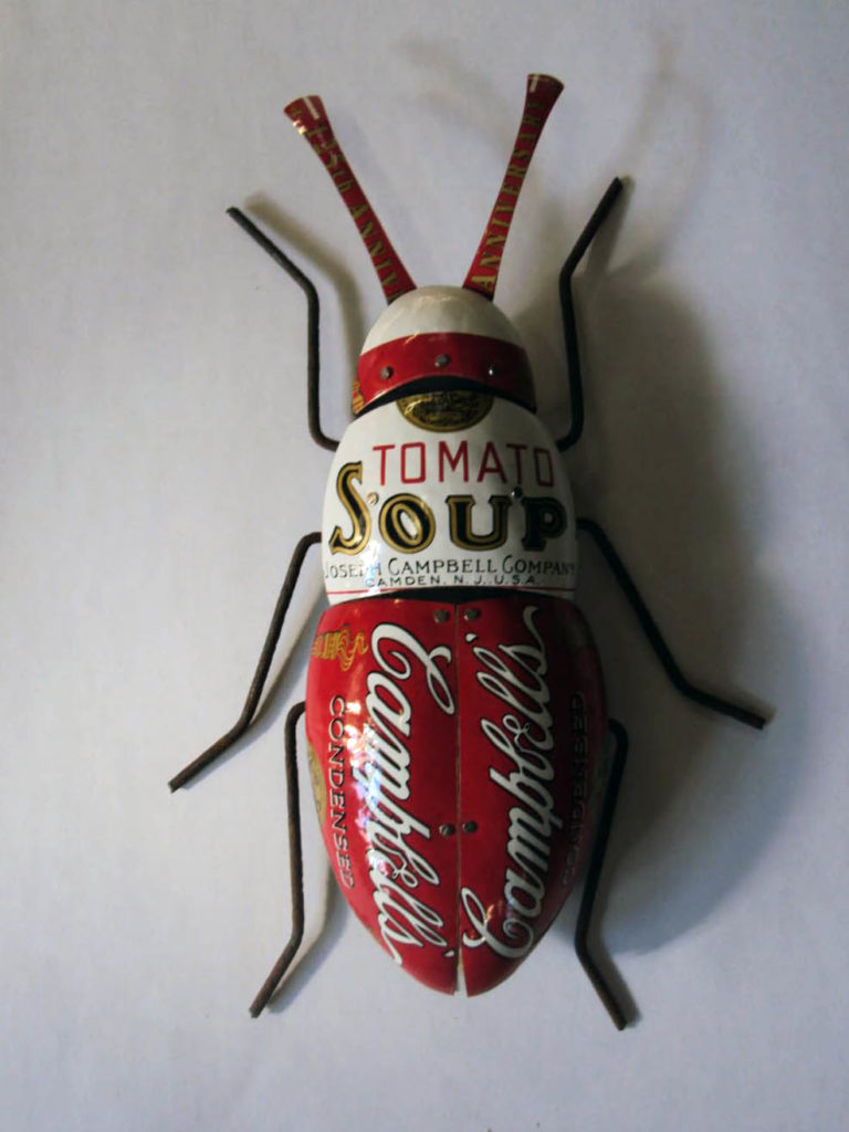 Hand carved plated beetle, pine with carefully fitted tin exoskeleton screwed in place, pose-able rusty fence wire legs