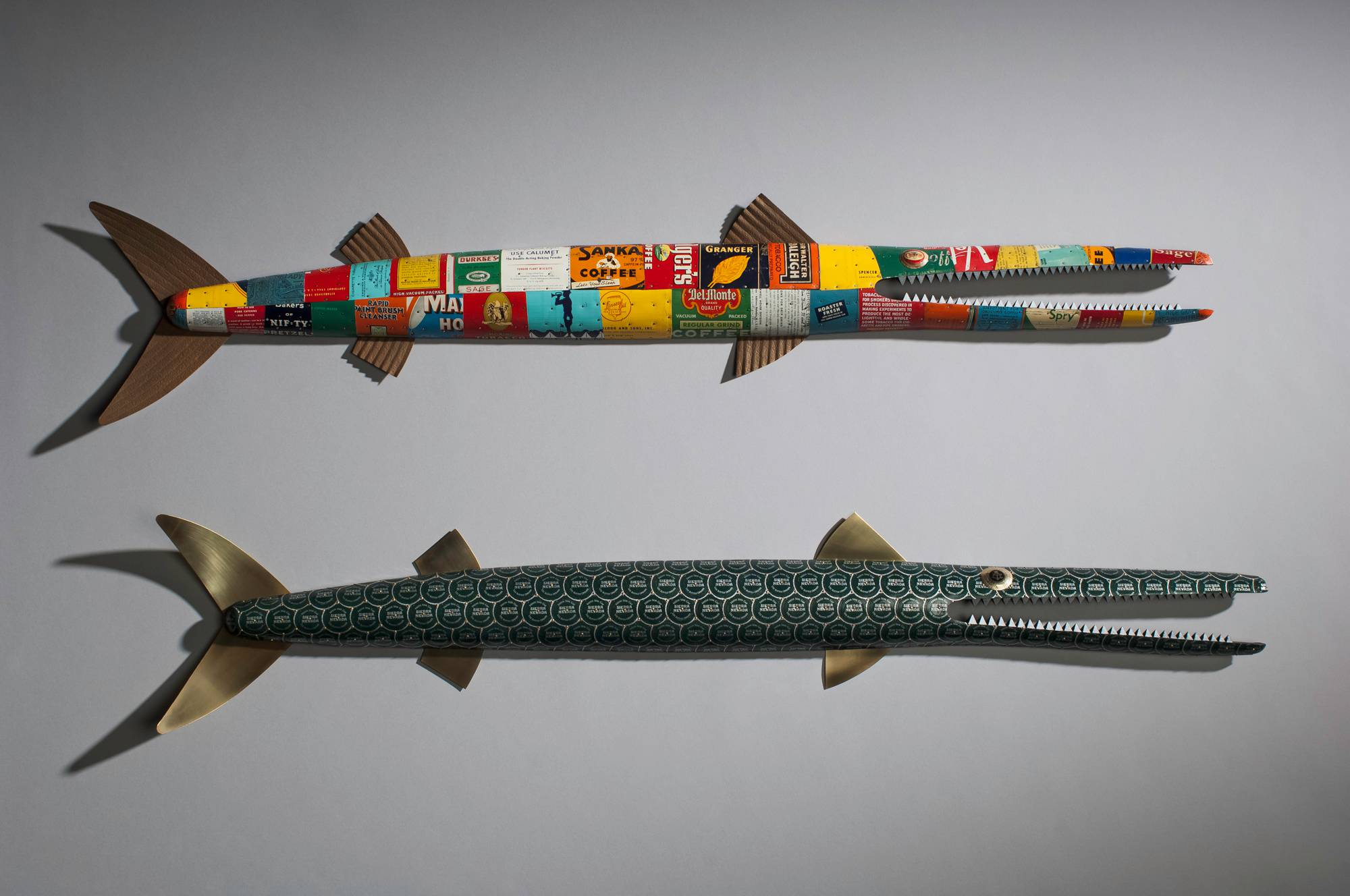 hand crafted wooden fish sculptures with metal plating and fins